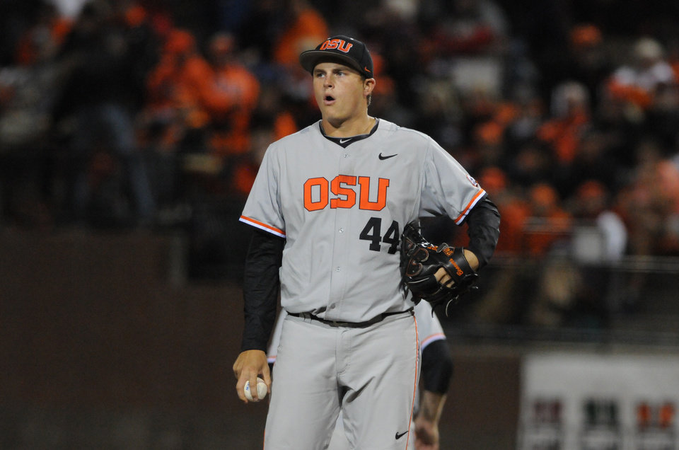Photo - Oregon State pitcher Jake Thompson pauses while pitching with the bases loaded against UC Irvine during an NCAA college baseball regional tournament game in Corvallis, Ore., Monday, June 2, 2014. (AP Photo/Mark Ylen)