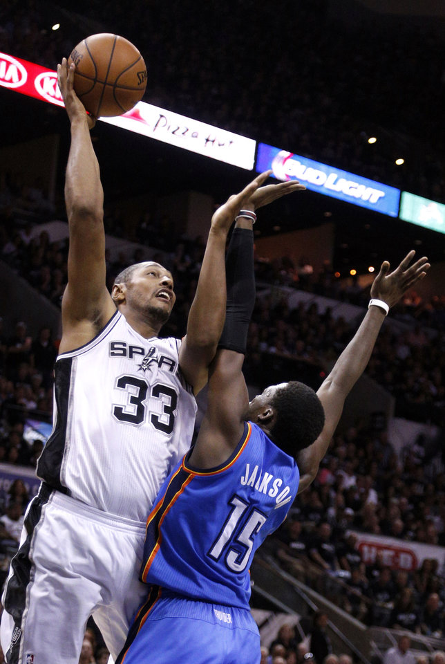 Photo - San Antonio's Boris Diaw (33) shoots over Oklahoma City's Reggie Jackson (15) during Game 1 of the Western Conference Finals in the NBA playoffs between the Oklahoma City Thunder and the San Antonio Spurs at the AT&T Center in San Antonio, Monday, May 19, 2014. Photo by Sarah Phipps, The Oklahoman