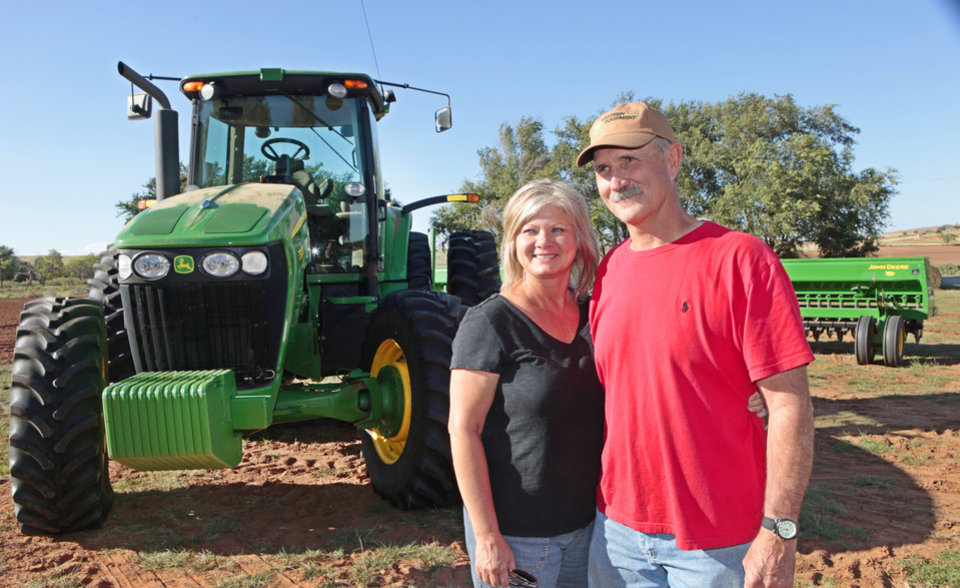 Photo - Tammy and Rick  Mercer, who live in Taloga, are shown near Taloga where Rick was planting wheat. They are the parents of Jordy Mercer of the Pittsburgh Pirates. PHOTO BY DAVID MCDANIEL, THE OKLAHOMAN   David McDaniel - The Oklahoman