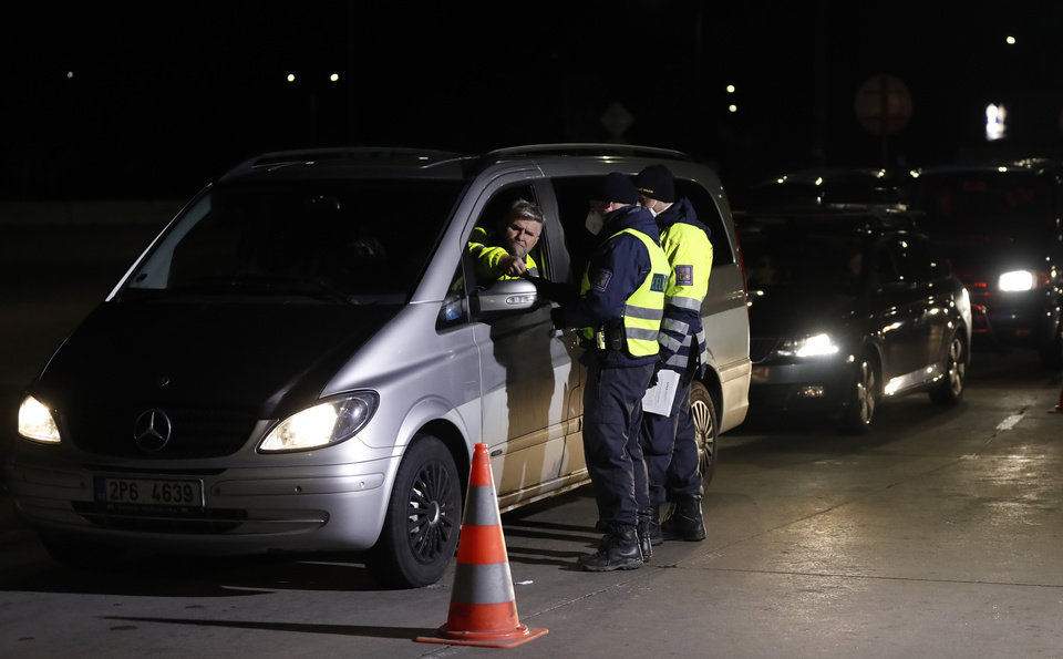 Photo -  Customs and police officers check the documents of a traveler at the border crossing with Germany in Rozvadov, Czech Republic, Friday, March 13, 2020. The Czech Republic has renewed the checks on the borders with Austria and Germany at midnight Friday, and is barring entry to citizens from 15