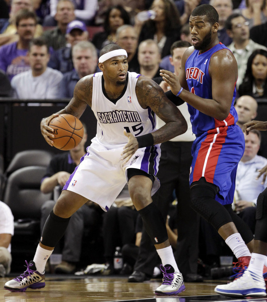 Sacramento Kings center DeMarcus Cousins (15) backs down on Detroit Pistons center Greg Monroe during the first half of an NBA basketball game in Sacramento, Calif., Wednesday, Nov. 7, 2012. (AP Photo/Rich Pedroncelli)