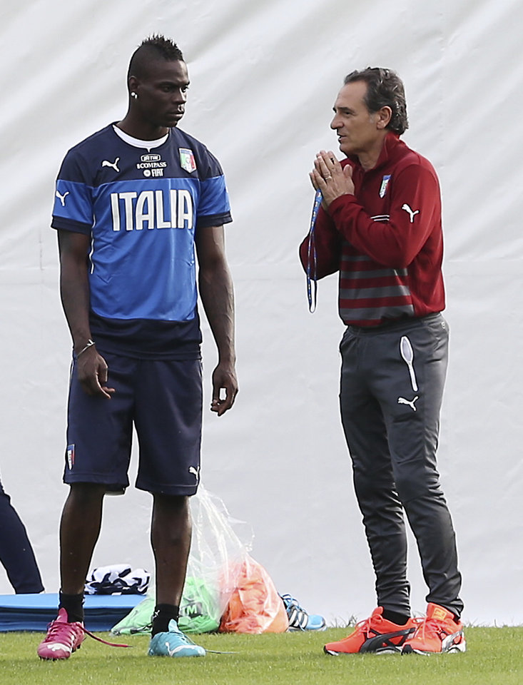 Photo - Italy coach Cesare Prandelli, right, talks with Italy forward Mario Balotelli during a training session for the upcoming World Cup at the Portobello training center in Mangaratiba, Brazil, Friday, June 6, 2014. Italy is part of Group D that includes Costa Rica, England and Uruguay. Italy will play England in Manaus in its opening match on June 14. (AP Photo/Antonio Calanni)
