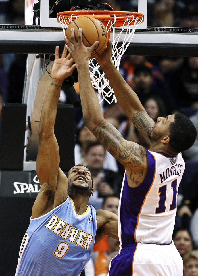 Photo -   Phoenix Suns' Markieff Morris (11) grabs a rebound in front of Denver Nuggets' Andre Iguodala (9) in the first half of an NBA basketball game, Monday, Nov. 12, 2012, in Phoenix. (AP Photo/Ross D. Franklin)