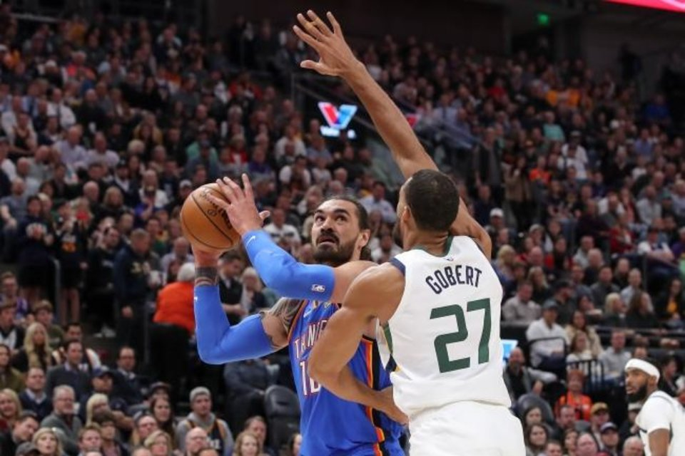 Photo -  Oct 23, 2019; Salt Lake City, UT, USA; Oklahoma City Thunder center Steven Adams (12) looks to shoot the ball past Utah Jazz center Rudy Gobert (27) arm during the first quarter at Vivint Smart Home Arena. Mandatory Credit: Chris Nicoll-USA TODAY Sports