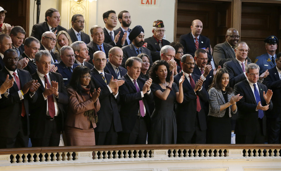 Photo - Members of New Jersey Gov. Chris Christie's cabinet and others stand in the gallery giving Christie a standing ovation as he delivers his State Of The State address at the Statehouse, Tuesday, Jan. 8, 2013, in Trenton, N.J. (AP Photo/Mel Evans)
