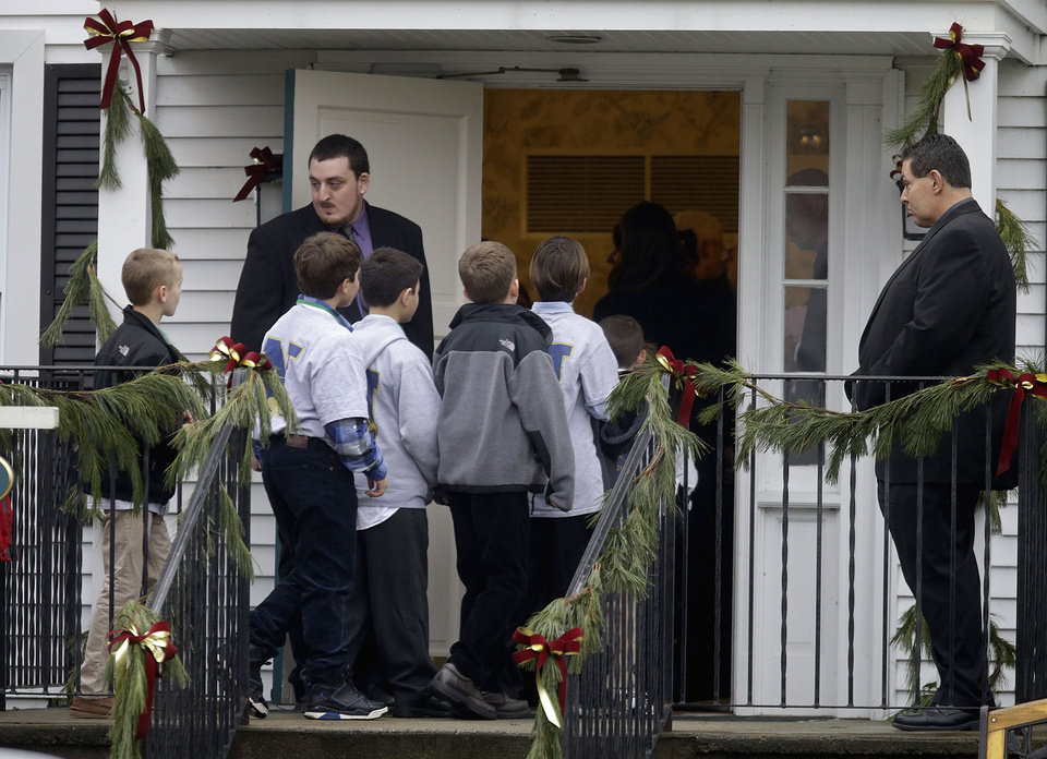 Photo - Mourners arrive at the funeral service for 6-year-old Jack Pinto, Monday, Dec. 17, 2012 in Newtown, Conn. Pinto was killed when a gunman walked into Sandy Hook Elementary School in Newtown Friday and opened fire, killing 26 people, including 20 children. (AP Photo/David Goldman)