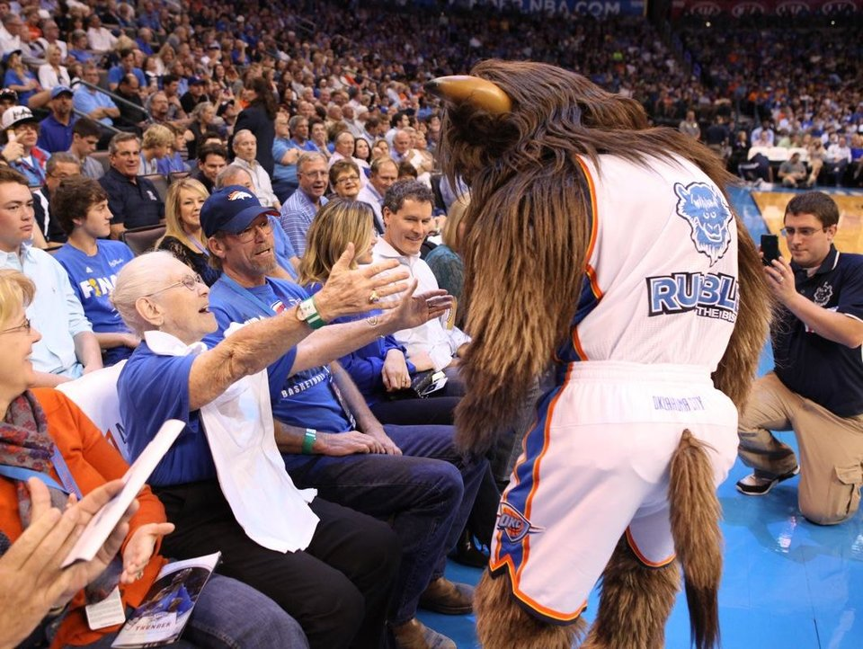 "Leola Boyd meets Rumble the Bison at the OKC Thunder's home opener on Friday, Nov. 2 in Chesapeake Energy Arena in Oklahoma City, Okla. <br /> <br />  A generous, anonymous Thunder fan provided Leola courtside seats for the game. <br /> <br />  <a href=""http://okne.ws/TtqzGL"">Here's the story from the evening from Berry Tramel.</a>"
