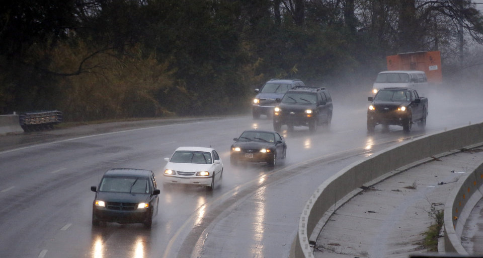 Photo - Heavy rains greeted drivers along I-55 in Jackson, Miss., Thursday, Jan. 10, 2013. These same rains also brought about isolated mudslides in Natchez, street flooding in Jackson and downed trees throughout the state. (AP Photo/Rogelio V. Solis)