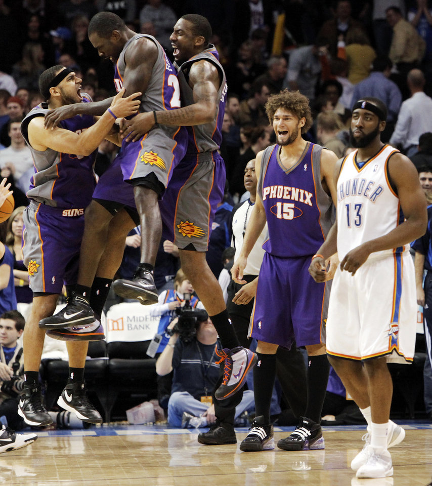 Photo - CELEBRATION: From left, Jared Dudley (3), Jason Richardson (23), Amar'e Stoudemire (1) and Robin Lopez (15) of Phoenix celebrate as Oklahoma City's James Harden (13) leaves the court after the NBA basketball game between the Phoenix Suns and the Oklahoma City Thunder at the Ford Center in Oklahoma City, Tuesday, Feb. 23, 2010. Phoenix won, 104-102. Photo by Nate Billings, The Oklahoman ORG XMIT: KOD
