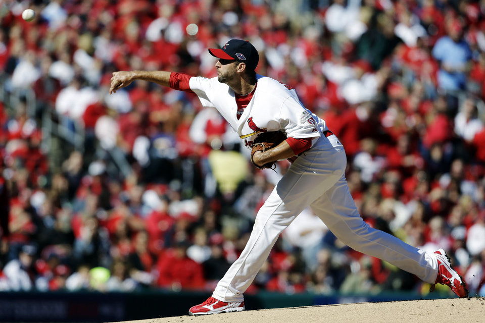 St. Louis Cardinals starting pitcher Adam Wainwright throws during the first inning in Game 1 of baseball's National League division series against the Washington Nationals, Sunday, Oct. 7, 2012, in St. Louis. (AP Photo/Jeff Roberson)