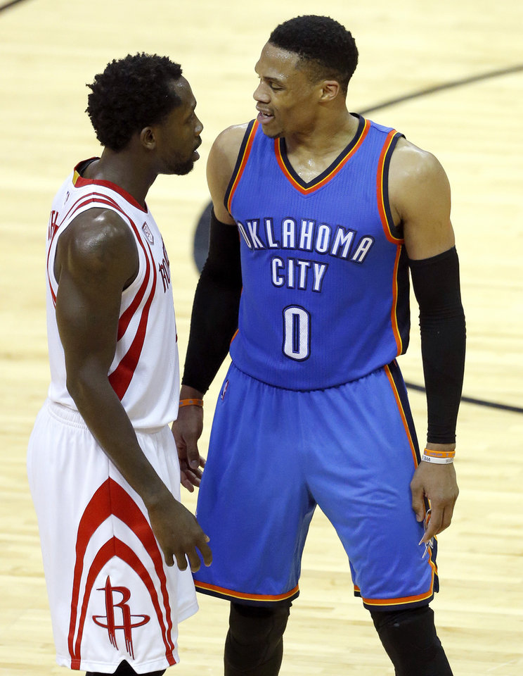Photo - Oklahoma City's Russell Westbrook (0) and Patrick Beverley (2) argue after a foul is called on Westbrook during Game 5 in the first round of the NBA playoffs between the Oklahoma City Thunder and the Houston Rockets in Houston, Texas,  Tuesday, April 25, 2017.  Photo by Sarah Phipps, The Oklahoman