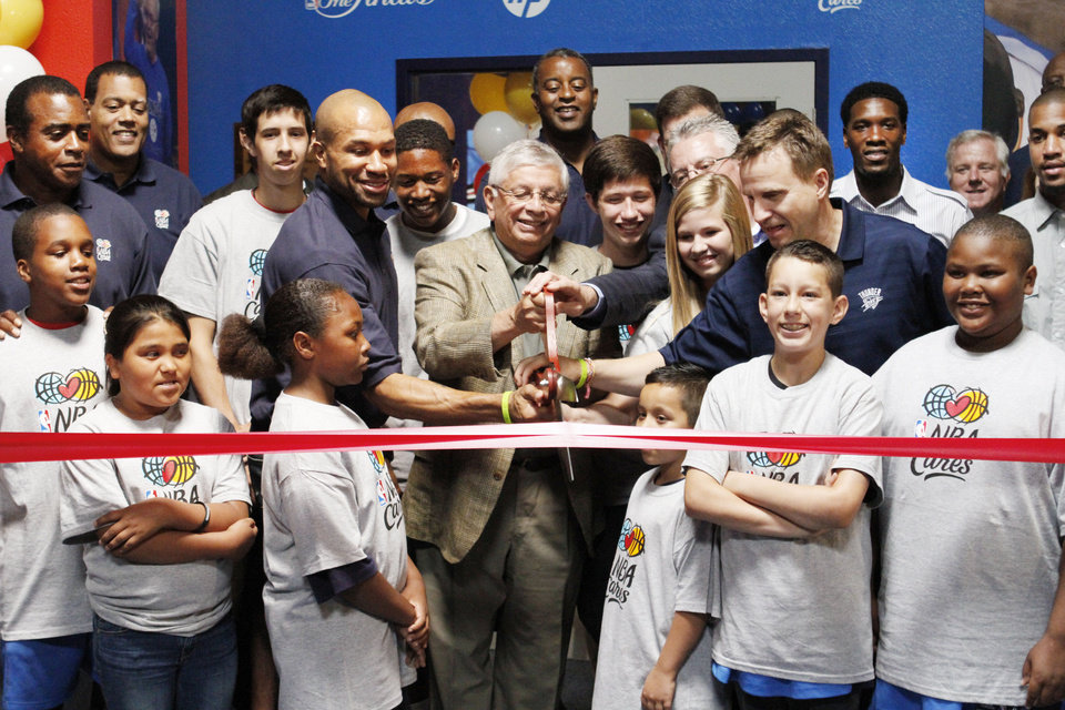 Photo - NBA Commissioner David Stern, center is joined by Thunder player Derek Fisher, left and Coach Scott Brooks, right  and other dignitaries for the opening of the NBA Cares Learn & Play Center at the City Rescue Mission in Oklahoma City. Photo By Steve Gooch, The Oklahoman  Steve Gooch - The Oklahoman