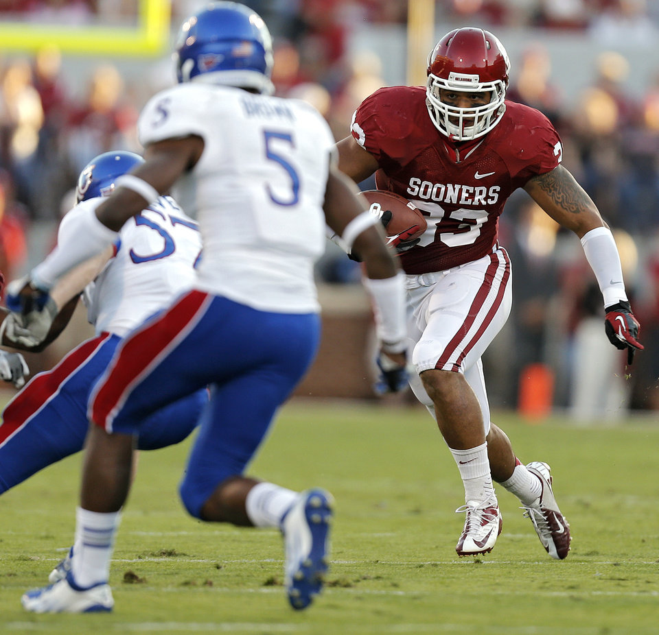OU's Trey Millard (33) looks for more running room past KU's Greg Brown (5) during the college football game between the University of Oklahoma Sooners (OU) and the University of Kansas Jayhawks (KU) at Gaylord Family-Oklahoma Memorial Stadium on Saturday, Oct. 20th, 2012, in Norman, Okla. Photo by Chris Landsberger, The Oklahoman