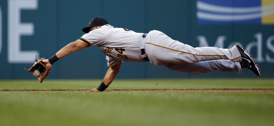 Photo - Pittsburgh Pirates third baseman Pedro Alvarez dives to field a hit by Washington Nationals' Denard Span, who was safe at first base on the play, during the first inning of a baseball game at Nationals Park, Friday, Aug. 15, 2014, in Washington. (AP Photo/Alex Brandon)