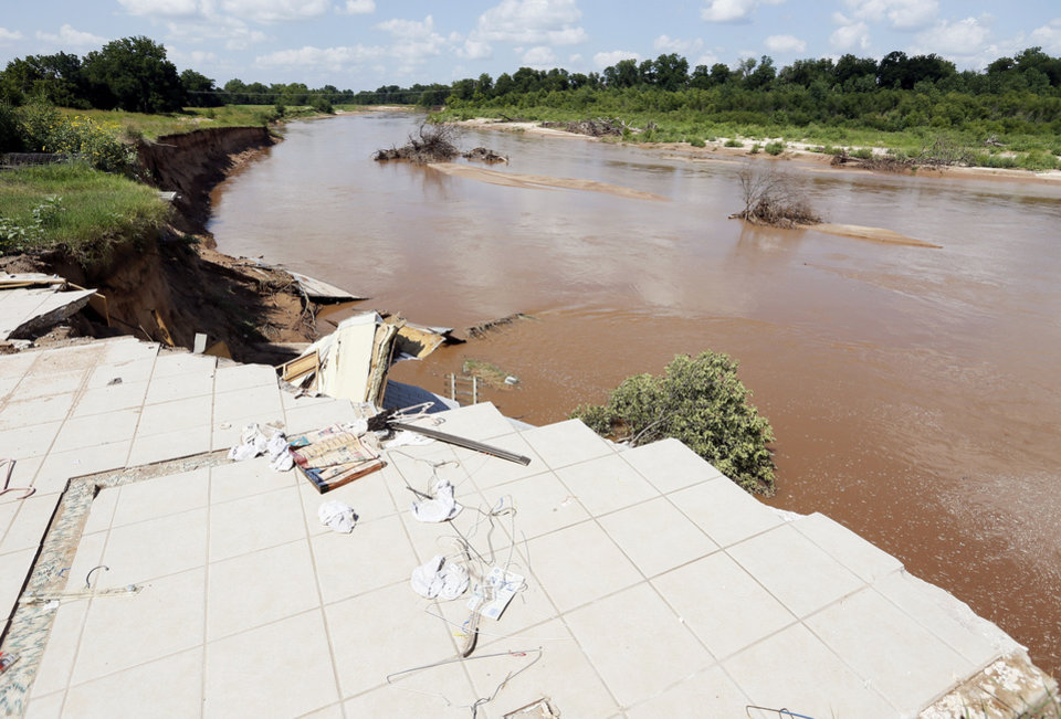 Photo - A view of the North Canadian River from the floor that is left of the smaller house that slid into the river from Gary and Rhonda Buford's property at 3800 N Triple X Road in Choctaw. Photo by Nate Billings, The Oklahoman  NATE BILLINGS - NATE BILLINGS