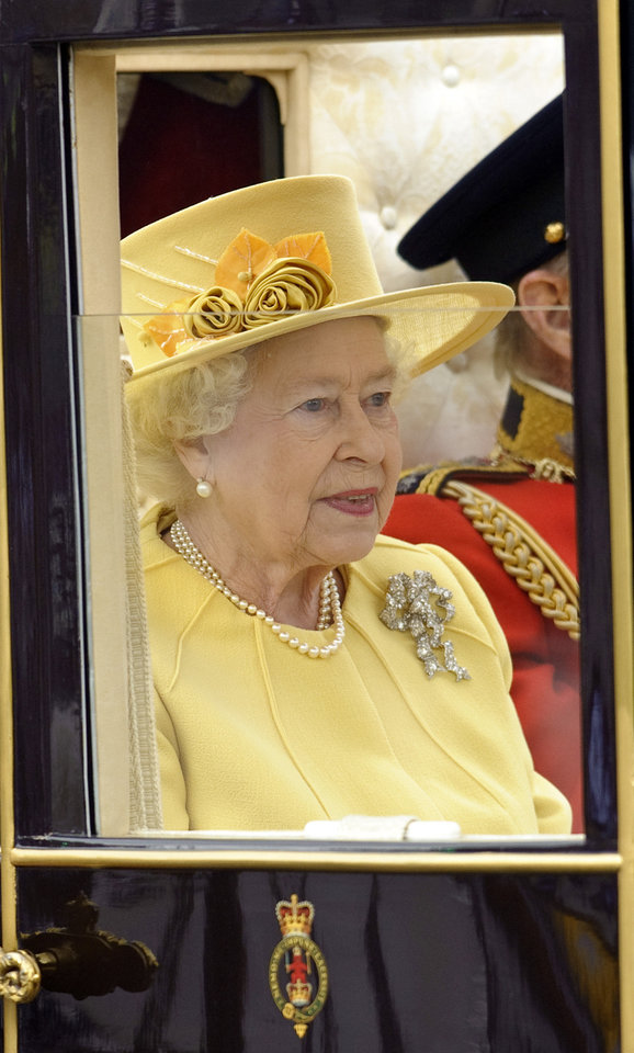 Photo - Britain's Queen Elizabeth II leaves Westminster Abbey following the wedding of Britain's Prince William and his wife Kate, the Duchess of Cambridge, as they make their way along the procession route to Buckingham Palace, London, Friday, April, 29, 2011. (AP Photo/Fiona Hanson, Pool) ORG XMIT: RWFH113