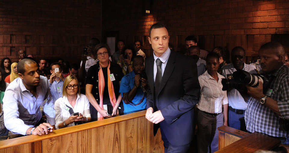 Photo - Olympic athlete, Oscar Pistorius , in court Friday Feb. 22, 2013 in Pretoria, South Africa, for his bail hearing charged with the shooting death of his girlfriend, Reeva Steenkamp. The defense and prosecution both completed their arguments with the magistrate soon to rule if the double-amputee athlete can be freed before trial or if he must stay behind bars pending trial. (AP Photo)