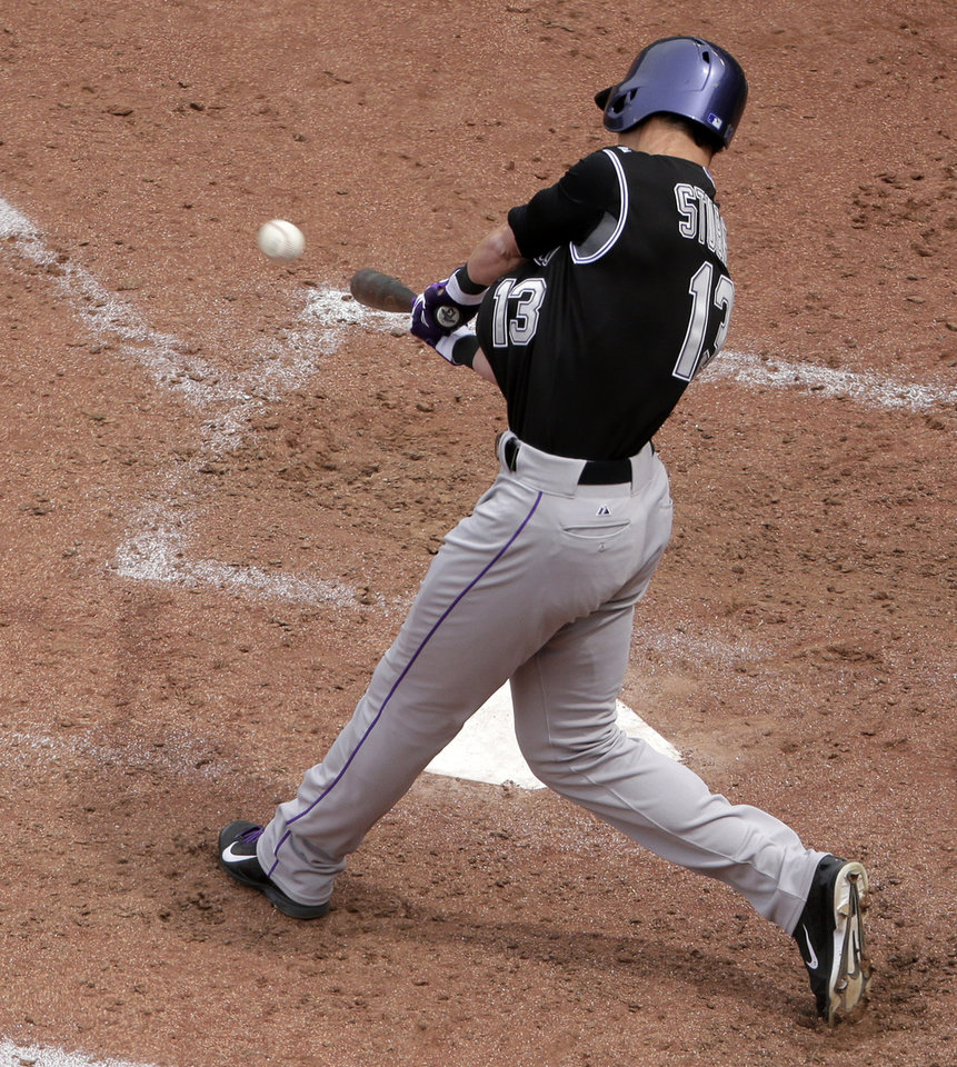 Photo - Colorado Rockies' Drew Stubbs (13) hits a two-run home run during the seventh inning of a baseball game against the Kansas City Royals Wednesday, May 14, 2014 in Kansas City, Mo. (AP Photo/Charlie Riedel)