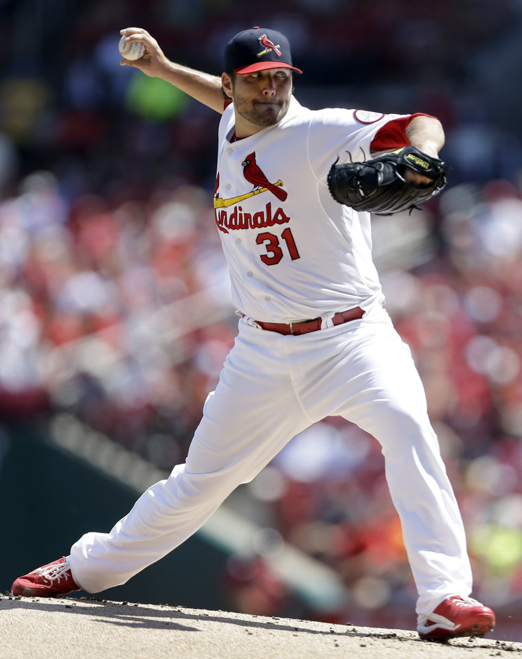 Photo - St. Louis Cardinals starting pitcher Lance Lynn throws during the first inning of a baseball game against the Atlanta Braves, Sunday, Aug. 25, 2013, in St. Louis. (AP Photo/Jeff Roberson)
