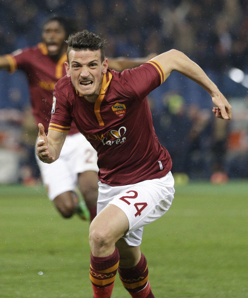 Photo - AS Roma midfielder Alessandro Florenzi celebrates after he scored during a Serie A soccer match between AS Roma and Torino, at Rome's Olympic Stadium, Tuesday, March 25, 2014. (AP Photo/Andrew Medichini)