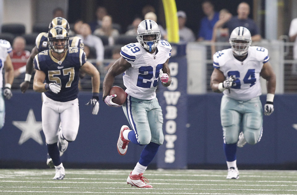 Photo -  St. Louis Rams linebacker Chris Chamberlain, left, chases DeMarco Murray on his 91-yard touchdown run during the Rams' 34-7 loss to the Dallas Cowboys on Sunday. AP PHOTO