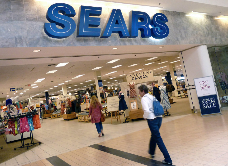 Photo - FILE - In this Monday, May 14, 2012, file photo, shoppers walk into Sears in Peabody, Mass. Sears reports quarterly earnings on Thursday, May 22, 2014. (AP Photo/Elise Amendola, File)