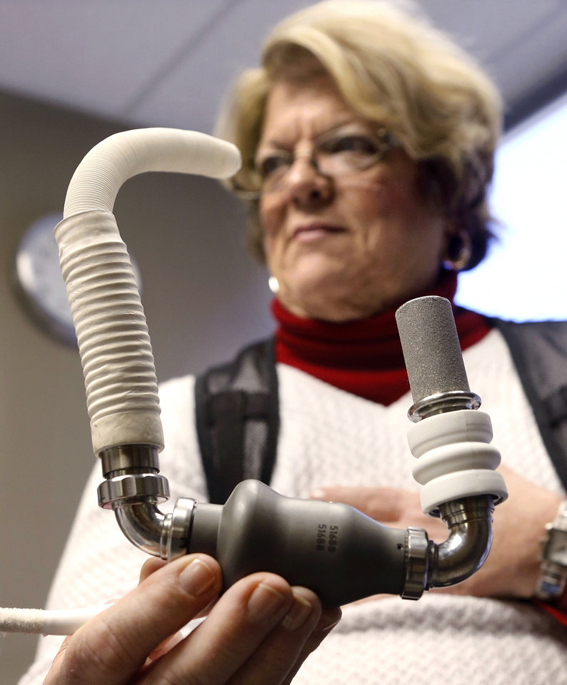 Pam Golden of Longtown holds a model of an LVAD (left ventricular assistance device). A similar pump was  implanted in her body to improve her circulation system.  Photographed at  Integris Baptist Hospital on Monday, Jan. 14, 2013.     Photo by Jim Beckel, The Oklahoman