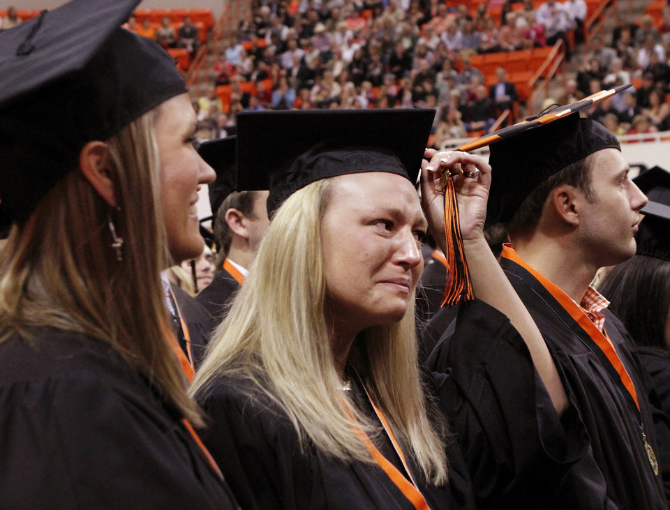Julie Hite of Glencoe, left, and Pamela Cochrane of Yukon,  display emotions after switching the tassels to the other side of their caps at the conclusion of graduation ceremony. Undergraduates at OSU participated in the school's 127th commencement ceremony the weekend of Friday, May 3 and Saturday, May 4, 2013 inside Gallagher-Iba Arena on the university's campus.These photos were taken at the Saturday morning ceremony when students from the College of Agricultural Sciences and Natural Resources, and the Spears School of Business were conferred with degrees.   Photo  by Jim Beckel, The Oklahoman.