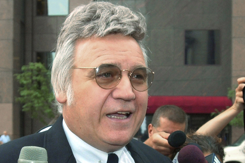 Photo - FILE - In this July 30, 2002 file photo, former U.S. Rep. James Traficant, Jr., speaks to reporters in Cleveland. Traficant was expelled from Congress in 2002 and served seven years in prison for accepting bribes and taking kickbacks. The Ohio Democrat tried to resurrect his political career and ran from prison in 2002 and again in 2010 after his release, but he failed to regain his seat. (AP Photo/Mark Duncan, File)