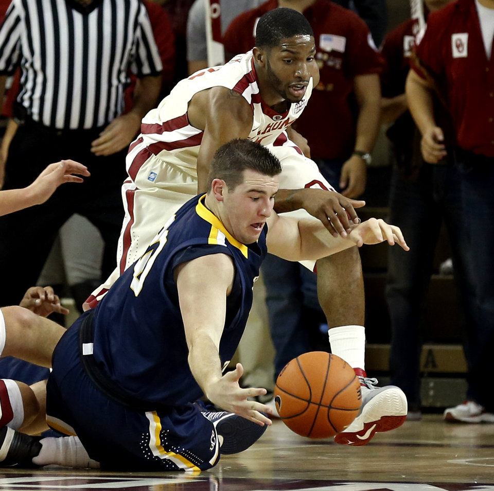Jacob Strassle (20) loses the ball and fights for possession with Sooner Cameron Clark as the University of Oklahoma (OU) Sooners men's basketball team plays the Central Oklahoma Bronchos at McCasland Field House on Wednesday, Nov. 7, 2012  in Norman, Okla. Photo by Steve Sisney, The Oklahoman