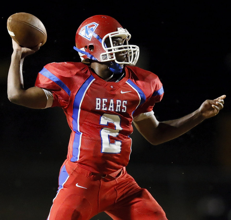 John Marshall's Lenard Levingston (2) passes during a high school football game between John Marshall and Crooked Oak at Star Spencer's Carl Twidwell Stadium, 3001 NE Spencer Rd., in Spencer, Okla., Thursday, Sept. 19, 2013. Photo by Nate Billings, The Oklahoman
