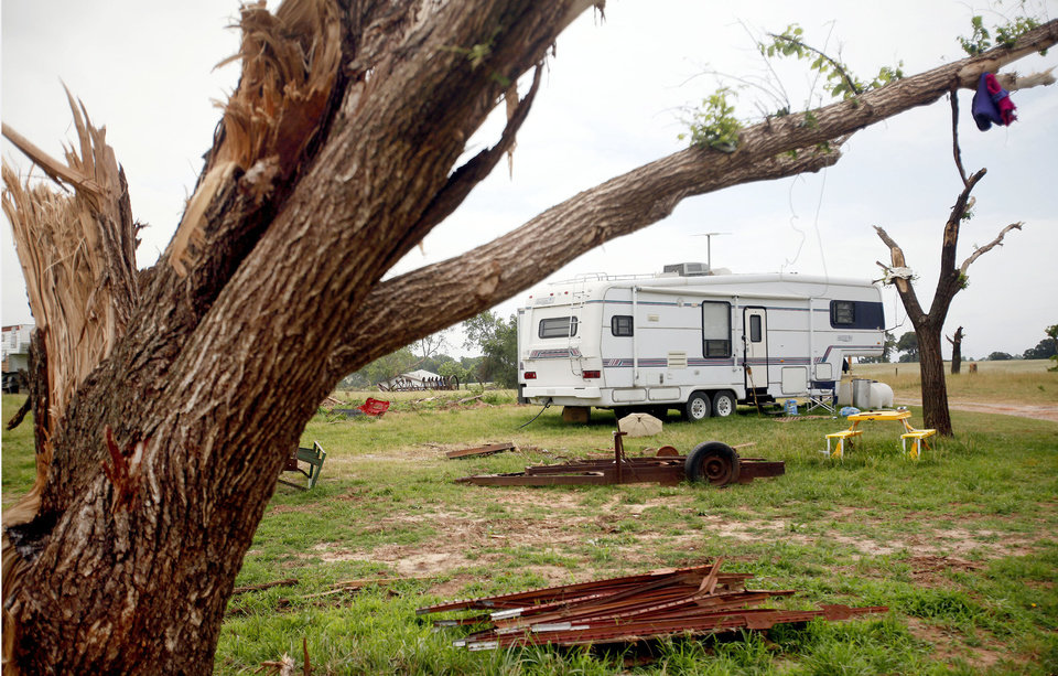 Photo - Howard and Jackie Dunsworth are living in a trailer on their property between Dale and Bethel Acres after a tornado destroyed their house on May 10. PHOTO BY MIRANDA GRUBBS, THE OKLAHOMAN