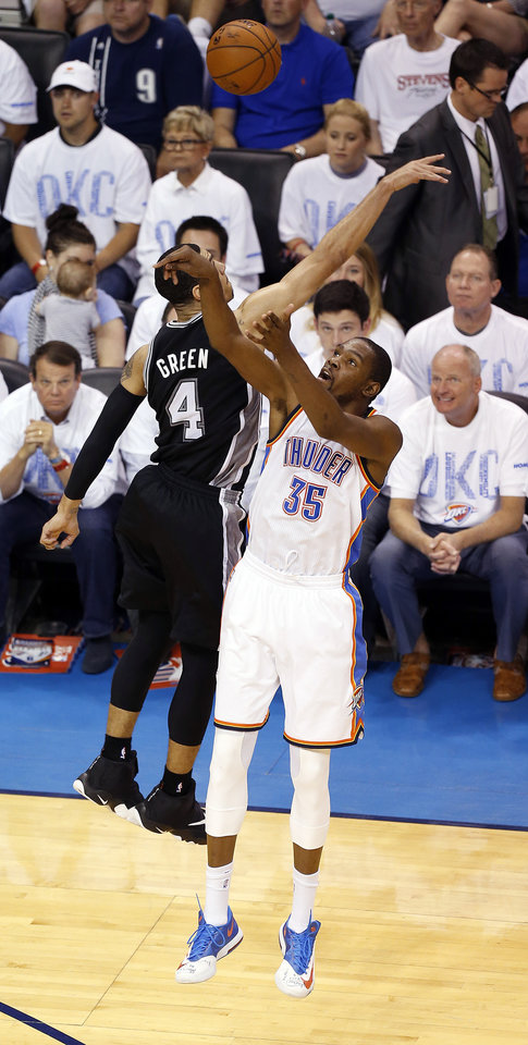 Photo - Oklahoma City's Kevin Durant (35) shoots as San Antonio's Danny Green (4) defends during Game 6 of the Western Conference Finals in the NBA playoffs between the Oklahoma City Thunder and the San Antonio Spurs at Chesapeake Energy Arena in Oklahoma City, Saturday, May 31, 2014. Photo by Nate Billings, The Oklahoman