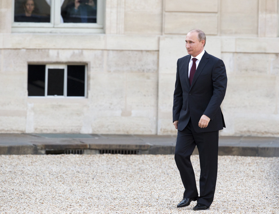 Photo - Russian President Vladimir Putin arrives for a meeting with French President Francois Hollande, at the Elysee Palace in Paris.  Thursday, June 5, 2014 where U.S. President Barack Obama, French president Francois Hollande and Britain's Queen Elizabeth II will gather in Normandy to remember the more than 9,000 Allied soldiers killed or wounded that day. (AP Photo/Jacques Brinon)