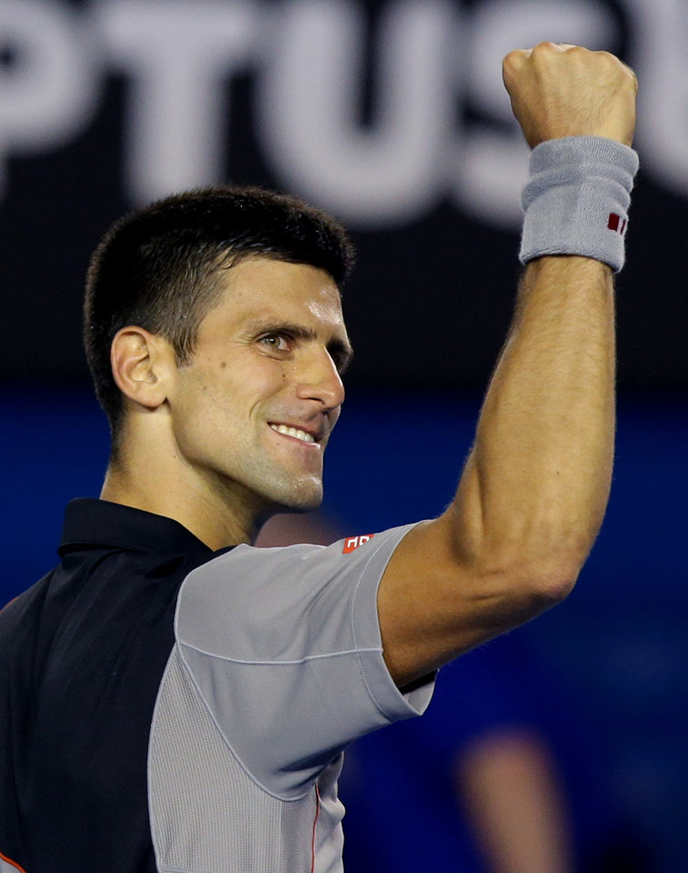 Photo - Novak Djokovic of Serbia celebrates after his win over Denis Istomin of Uzbekistan during their third round match at the Australian Open tennis championship in Melbourne, Australia, Friday, Jan. 17, 2014.(AP Photo/Aaron Favila)