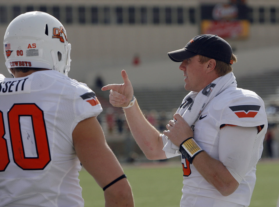 Photo - Oklahoma State's Brandon Weeden (3) talks to teammates on the sidelines during a college football game between Texas Tech University (TTU) and Oklahoma State University (OSU) at Jones AT&T Stadium in Lubbock, Texas, Saturday, Nov. 12, 2011.  Photo by Sarah Phipps, The Oklahoman  ORG XMIT: KOD