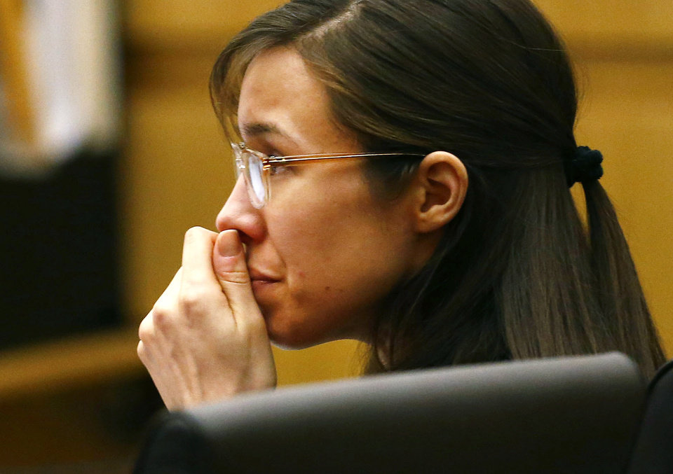 Photo - Defendant Jodi Arias listens to defense attorney Kirk Nurmi make his closing arguments during her trial on Friday, May 3, 2013 at Maricopa County Superior Court in Phoenix.  Arias is charged with first-degree murder in the stabbing and shooting death of Travis Alexander, 30, in his suburban Phoenix home in June 2008. (AP Photo/The Arizona Republic, Rob Schumacher, Pool)