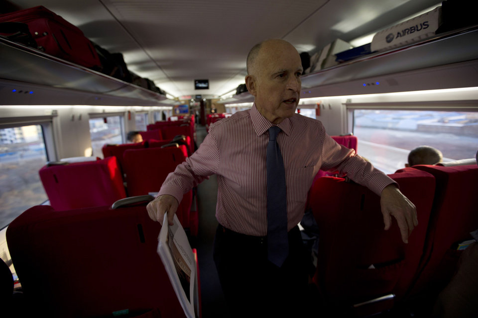 California Gov. Jerry Brown speaks to journalists on board a high speed rail leaving from the Beijing South train station in Beijing, China, Thursday, April 11, 2013. Brown highlighted his state's interest in infrastructure by traveling on China's high-speed rail system, which is the longest in the world. (AP Photo/Ng Han Guan)