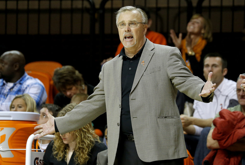 Oklahoma State coach Jim Littell rects during a women's college basketball game between Oklahoma State University (OSU) and Kansas at Gallagher-Iba Arena in Stillwater, Okla., Tuesday, Jan. 8, 2013. Oklahoma State won 76-59. Photo by Bryan Terry, The Oklahoman
