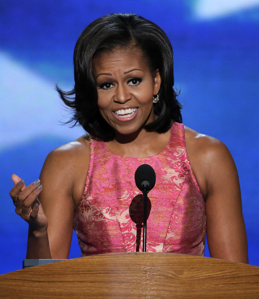 Photo - First Lady Michelle Obama addresses the Democratic National Convention in Charlotte, N.C., on Tuesday, Sept. 4, 2012. (AP Photo/J. Scott Applewhite)  ORG XMIT: DNC188
