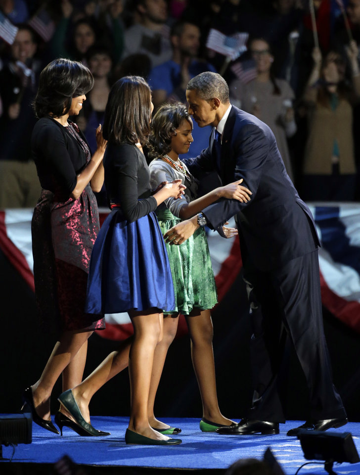 Photo -   President Barack Obama hugs his daugher Sasha after his speech as his wife Michelle and daughter Malia gather on stage at his election night party Wednesday, Nov. 7, 2012, in Chicago. President Obama defeated Republican challenger former Massachusetts Gov. Mitt Romney. (AP Photo/Pablo Martinez Monsivais)