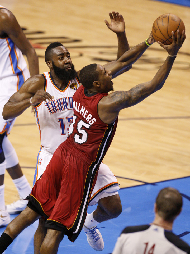 Miami's Mario Chalmers (15) goes past Oklahoma City's James Harden (13) goes past during Game 1 of the NBA Finals between the Oklahoma City Thunder and the Miami Heat at Chesapeake Energy Arena in Oklahoma City, Tuesday, June 12, 2012. Photo by Nate Billings, The Oklahoman