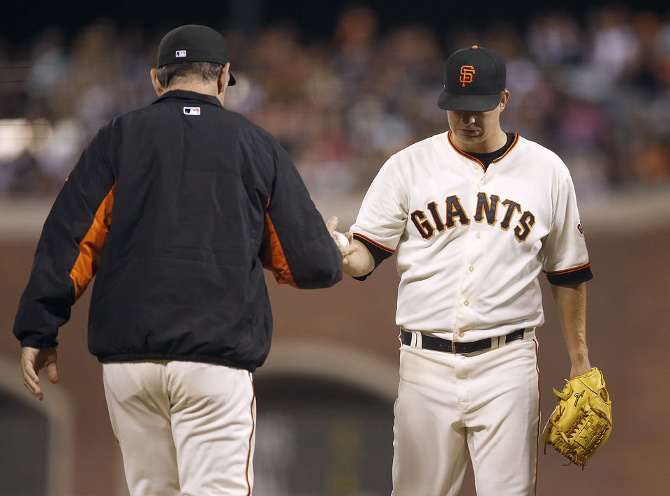 Photo - San Francisco Giants pitcher Matt Cain, right, is taken out of the game by  manager Bruce Bochy during the eighth inning against the San Diego Padres in a baseball game in San Francisco, Monday, June 23, 2014. (AP Photo/Tony Avelar)