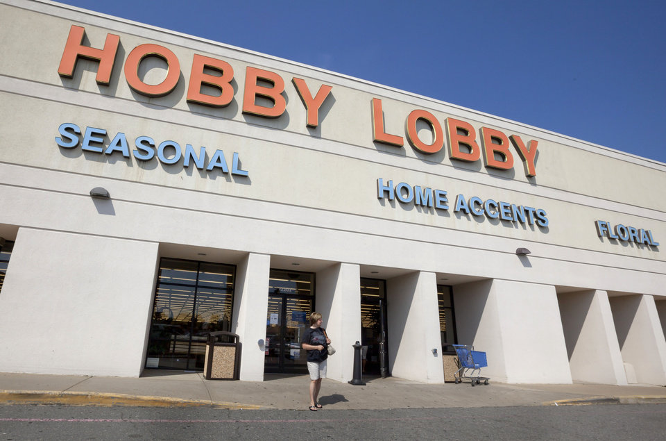 Photo -   FILE - In this Sept. 12, 2012 file photo, a woman walks from a Hobby Lobby Inc., store in Little Rock, Ark. Hobby Lobby Stores, the arts and craft supply chain that wants to block enforcement part of the new federal health care law that requires employers to cover insurance costs for the morning-after pill and the week-after pill is heading to court. Lawyers for the Oklahoma-based Hobby Lobby Stores say the federal law is unconstitutional and violates the company's owners' religious beliefs by forcing them to fund the pills, which they say effectively cause an abortion. The company says failure to provide such insurance could lead to fines of up to $1.3 million a day. (AP Photo/Danny Johnston, File)