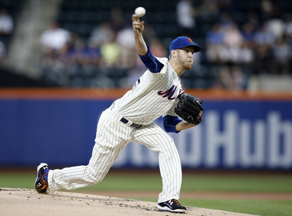 Photo - New York Mets starting pitcher Zack Wheeler delivers in the first inning of an interleague baseball game against the Oakland Athletics in New York, Wednesday, June 25, 2014. (AP Photo/Kathy Willens)