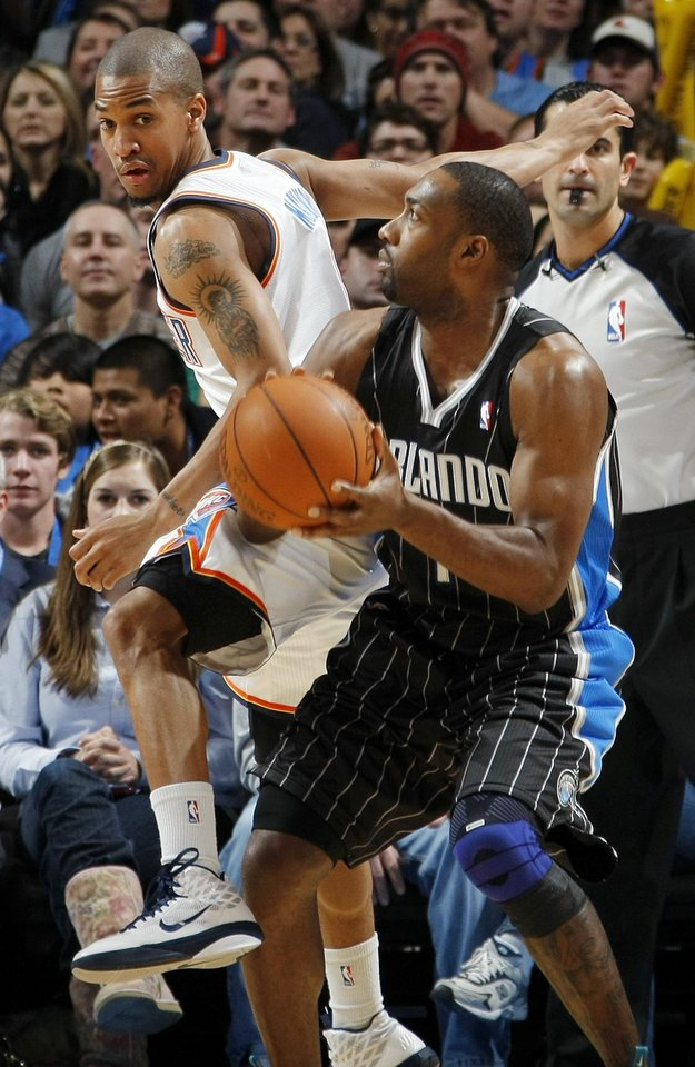 Photo - Orlando's Gilbert Arenas (1) looks to take a shot around Eric Maynor (6) of Oklahoma City during the NBA basketball game between the Orlando Magic and Oklahoma City Thunder in Oklahoma City, Thursday, January 13, 2011. Oklahoma City won, 125-124. Photo by Nate Billings, The Oklahoman