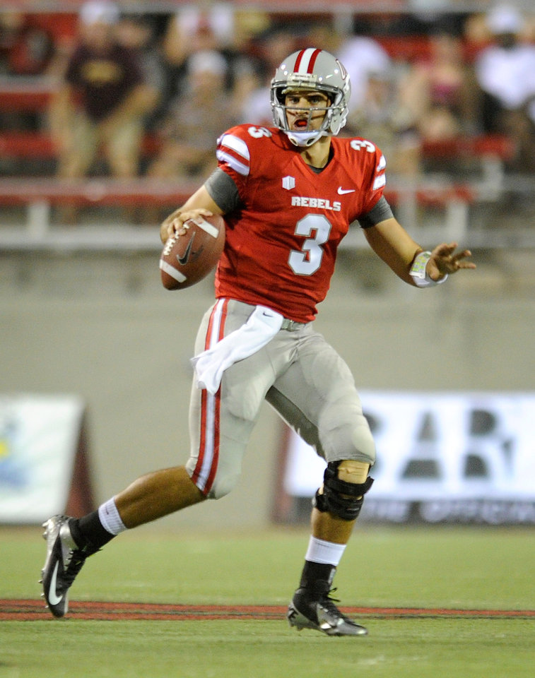 Photo -   UNLV's quarterback Nick Sherry (3) scrambles during first half action at his NCAA college football game and Minnesota at Sam Boyd Stadium, Thursday, Aug. 30, 2012 in Las Vegas. (AP Photo/David Becker)