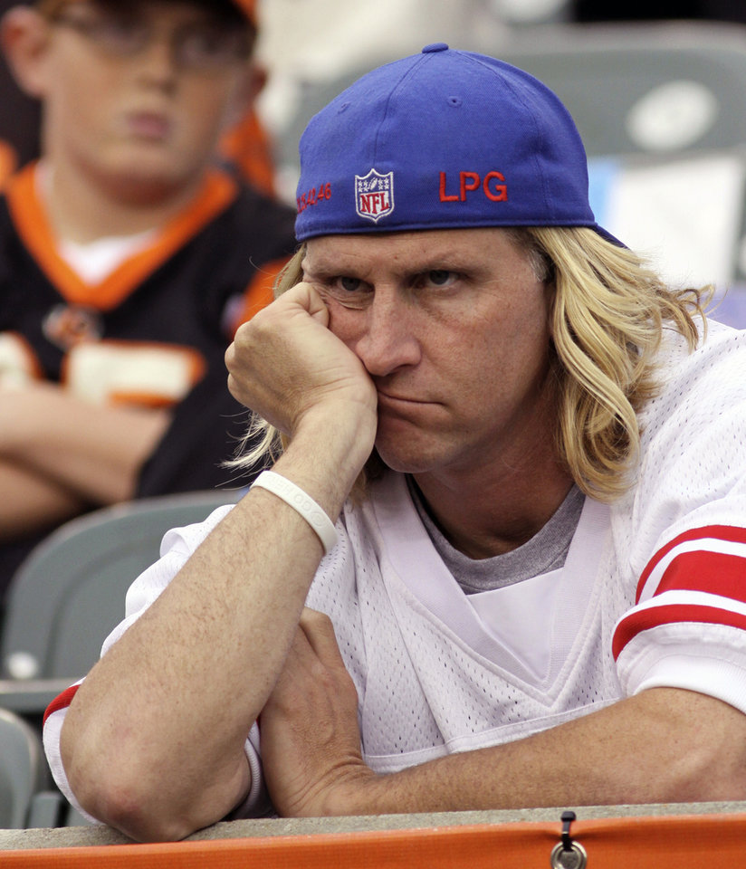 Photo -   A New York Giants fan watches in the closing minute of a 31-13 loss to the Cincinnati Bengals in an NFL football game on Sunday, Nov. 11, 2012, in Cincinnati. (AP Photo/Tom Uhlman)