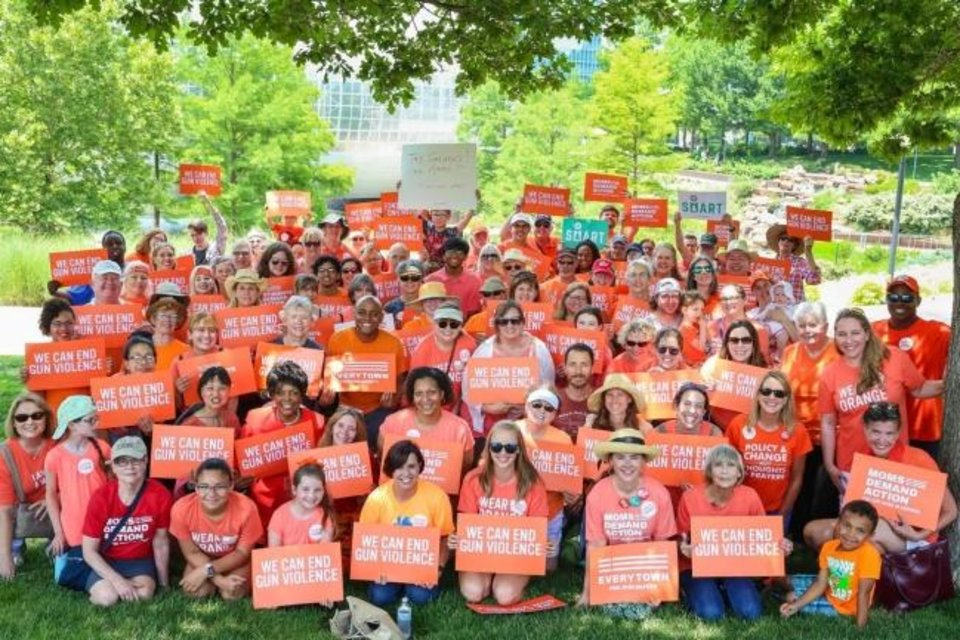 Photo -  Moms Demand Action for Gun Sense in America volunteers and supporters are pictured here at a Wear Orange event in honor of National Gun Violence Awareness Day in 2018. The group is holding a similar event at 10 a.m. Saturday in Oklahoma City. [Photo provided]