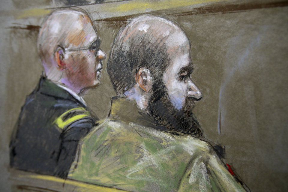 Photo - File - In this Aug. 21, 2013 file courtroom sketch, U.S. Army Maj. Nidal Malik Hasan, right, and his defense attorney, Lt. Col. Kris Poppe, are shown during Hasan's court-martial trial in Fort Hood, Texas. Hasan has been convicted of murder for the 2009 shooting rampage at Fort Hood that killed 13 people and wounded more than 30 others. (AP Photo/Brigitte Woosley, File)